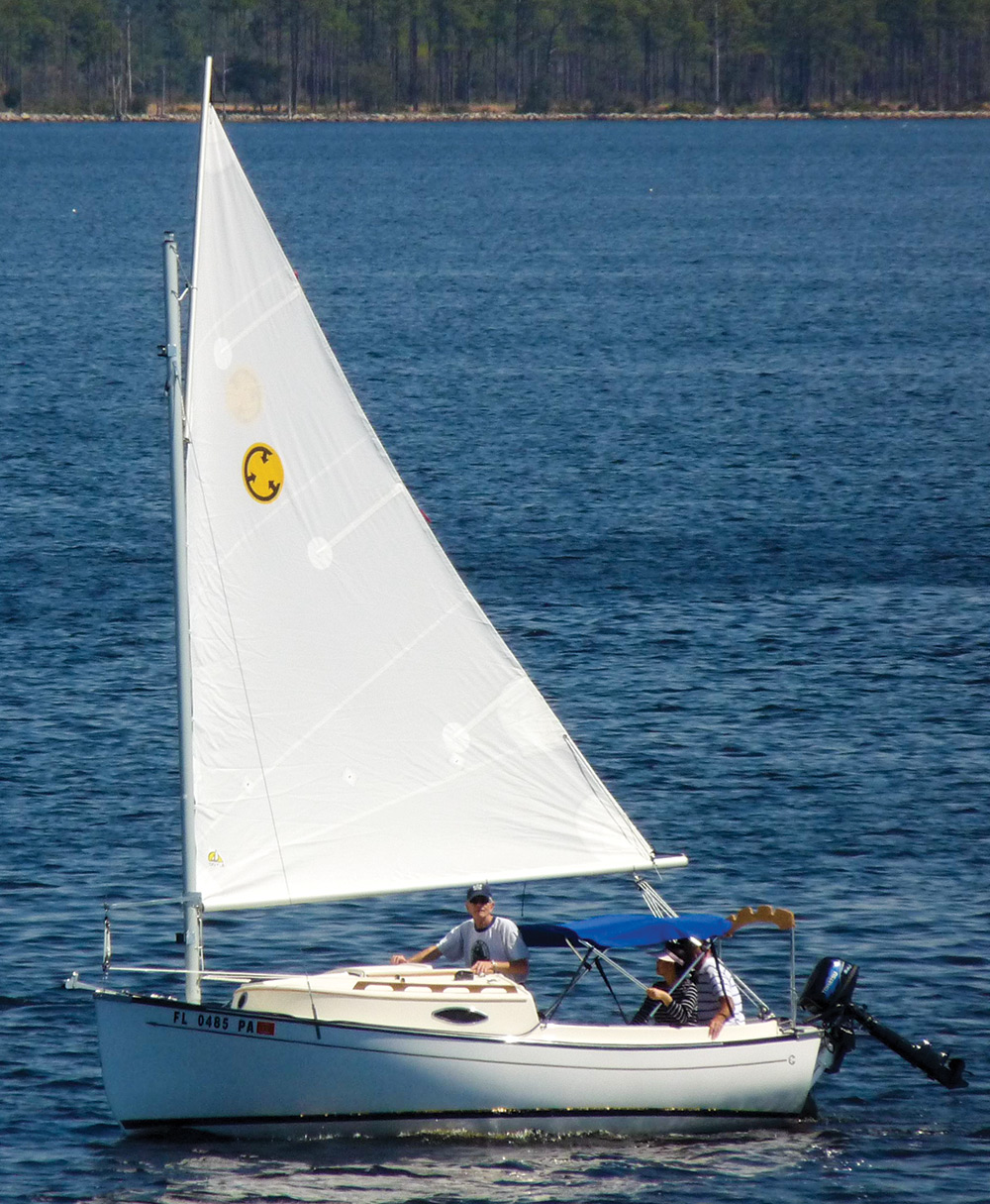 Clark Mills envisioned a trailerable boat that was easy to rig, simple to  sail, and would draw just enough water to make it suitable for breezing  across ...