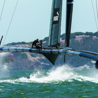 Caption: Oracle Racing USA makes waves during a practice on the Bay Credits: ACEA / PHOTO GILLES MARTIN-RAGET